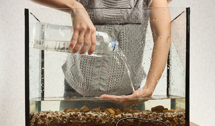 how to add water to a fish tank